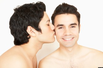 Shirtless gay couple kissing