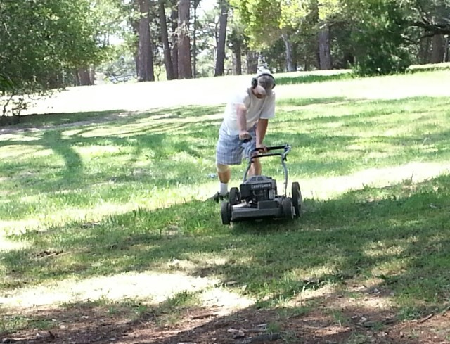 Local pro and longtime course maintenance leader Jim Hagen works on his backhand form while starting up his mower four days before the start of the 2013 Masters Cup.