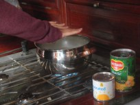 Warming hands while making corn chowder