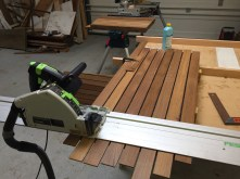 This is why we don't do this at home; the proper tools make all the difference. Here I am cutting the teak to size.