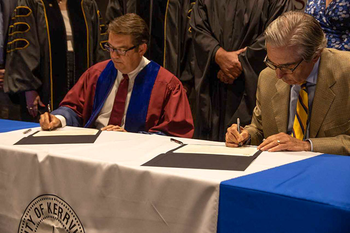 Town Gown Compact Signing