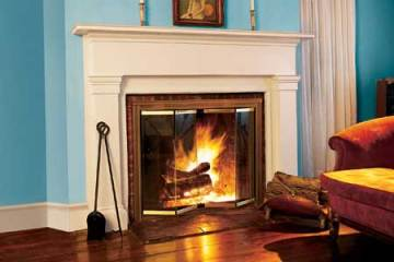 Installing fireplace doors is one way to improve efficiency. Image via www.thisoldhouse.com
