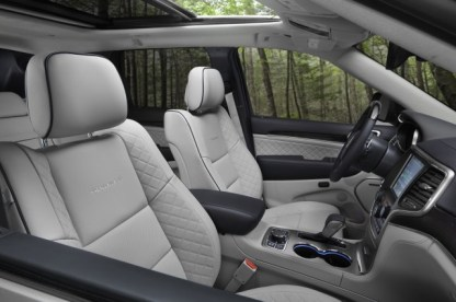 """Jeep Grand Cherokee Summit """"Gorgeous semi-aniline leather, open pore wood, and even plastics tinted in unusual shades help the Grand Cherokee stand out in a sea of average SUVs and crossovers"""""""