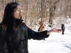 SONSI member feeds downy woodpecker