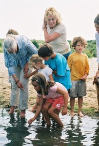 http://en.wikipedia.org/wiki/Jane_Goodall#/media/File:Jane_Goodall_sharing_the_magical_wonders_of_water_and_wetlands_with_children_on_Martha%27s_Vineyard.jpg