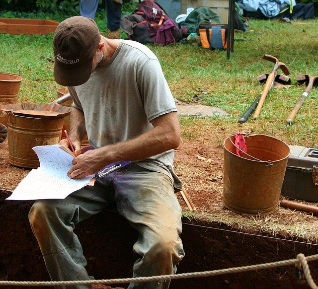 Paleontologist writing notes about a recent dig.