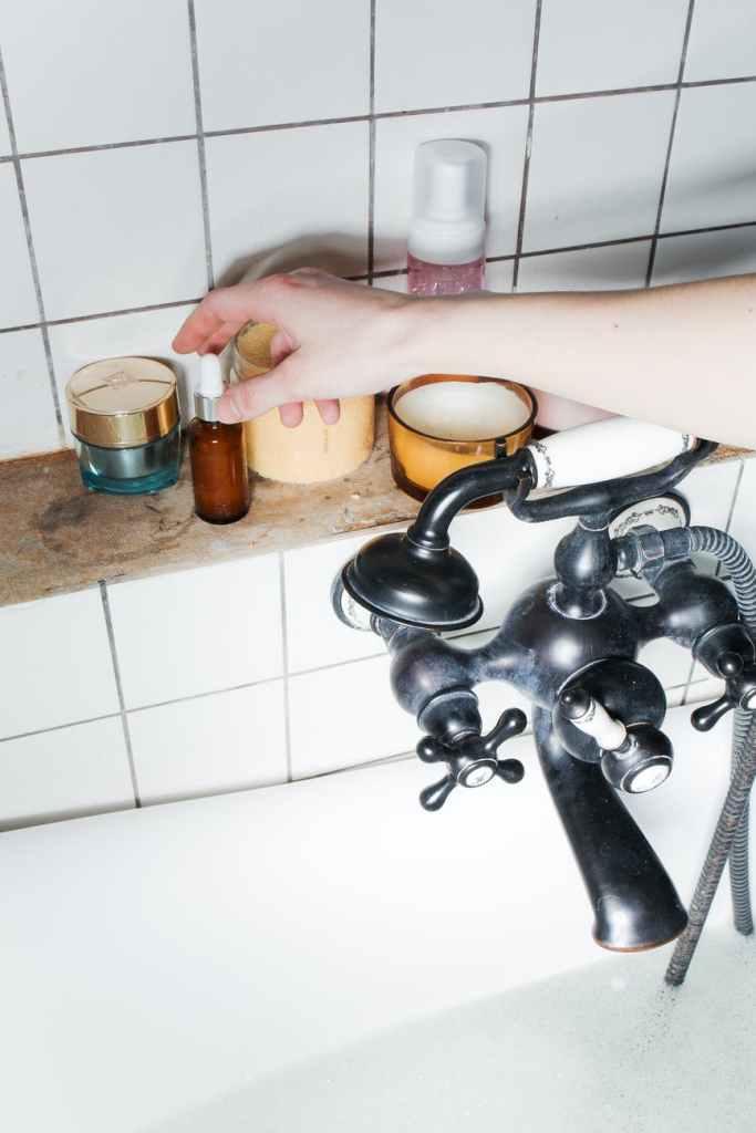 person preparing the bath with essential oil