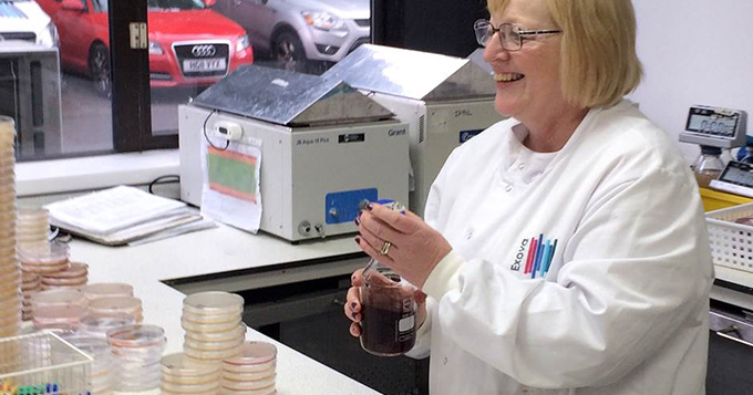 Service provider scientist holding a flask in a lab