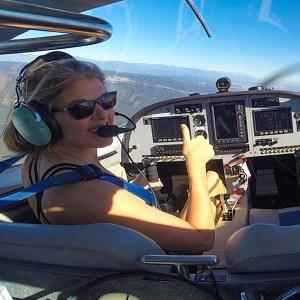 Alicia piloting a plane