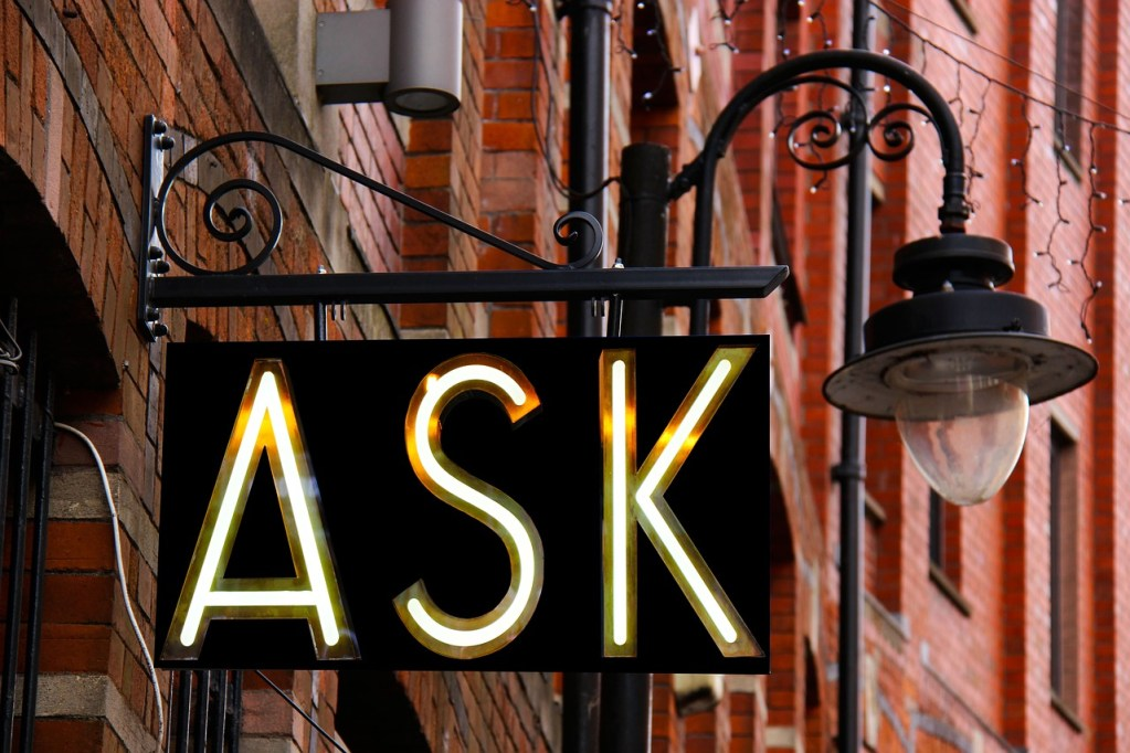 copywriting - image of ask sign above shop