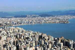 O peso colossal das cidades está causando o afundamento, mesmo com o aumento do nível do mar