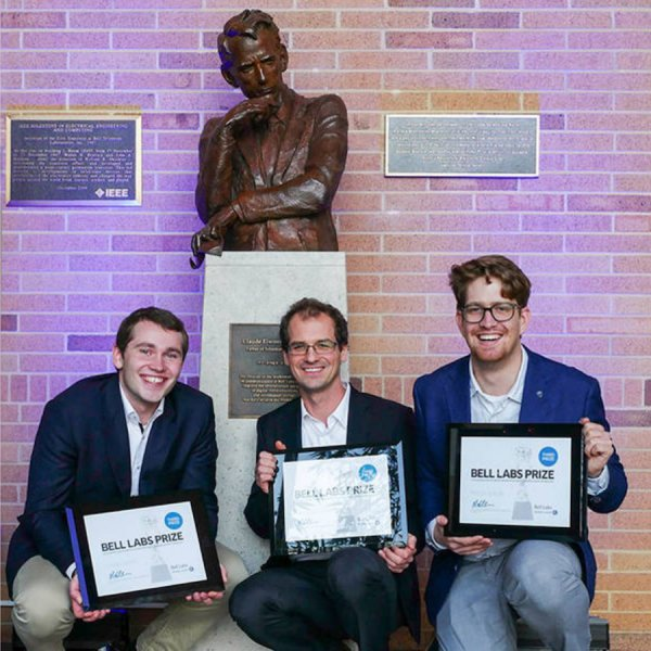 TUM researchers (l-r) Fabian Steiner, Georg Böcherer, and Patrick Schulte with the statue of Claude Shannon, father of information theory. Credit: Denise Panyik-Dale/Alcatel-Lucent