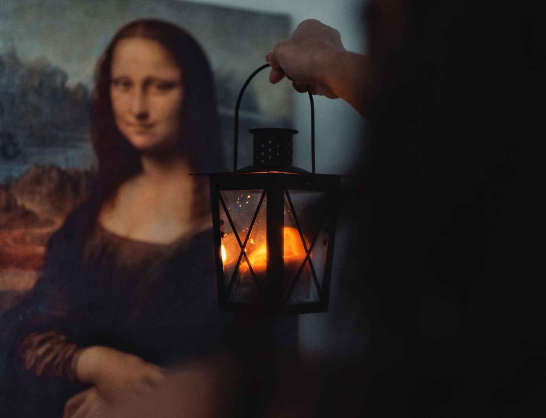 person holding lantern
