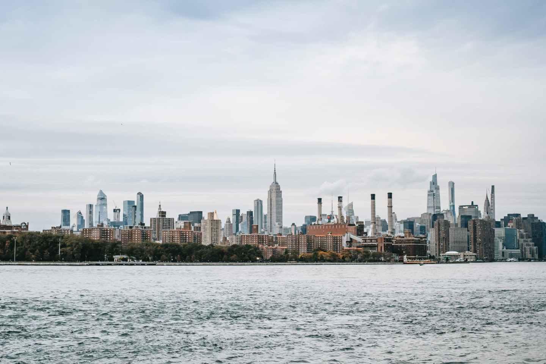 cityscape of modern urban megapolis on river coast