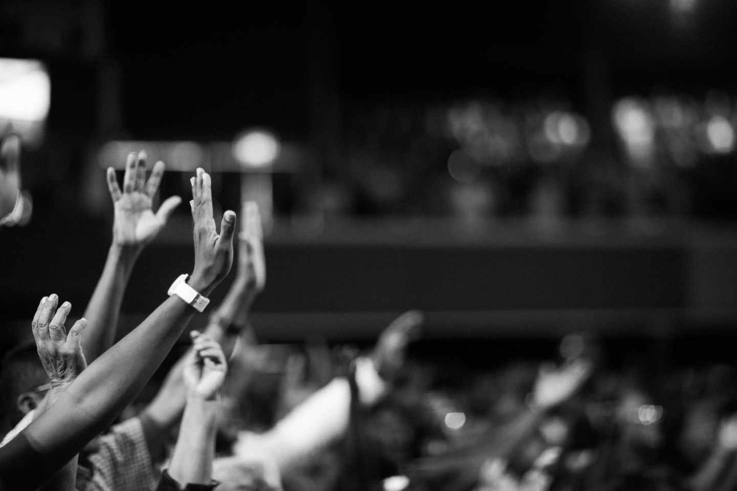 grayscale photography of hands waving