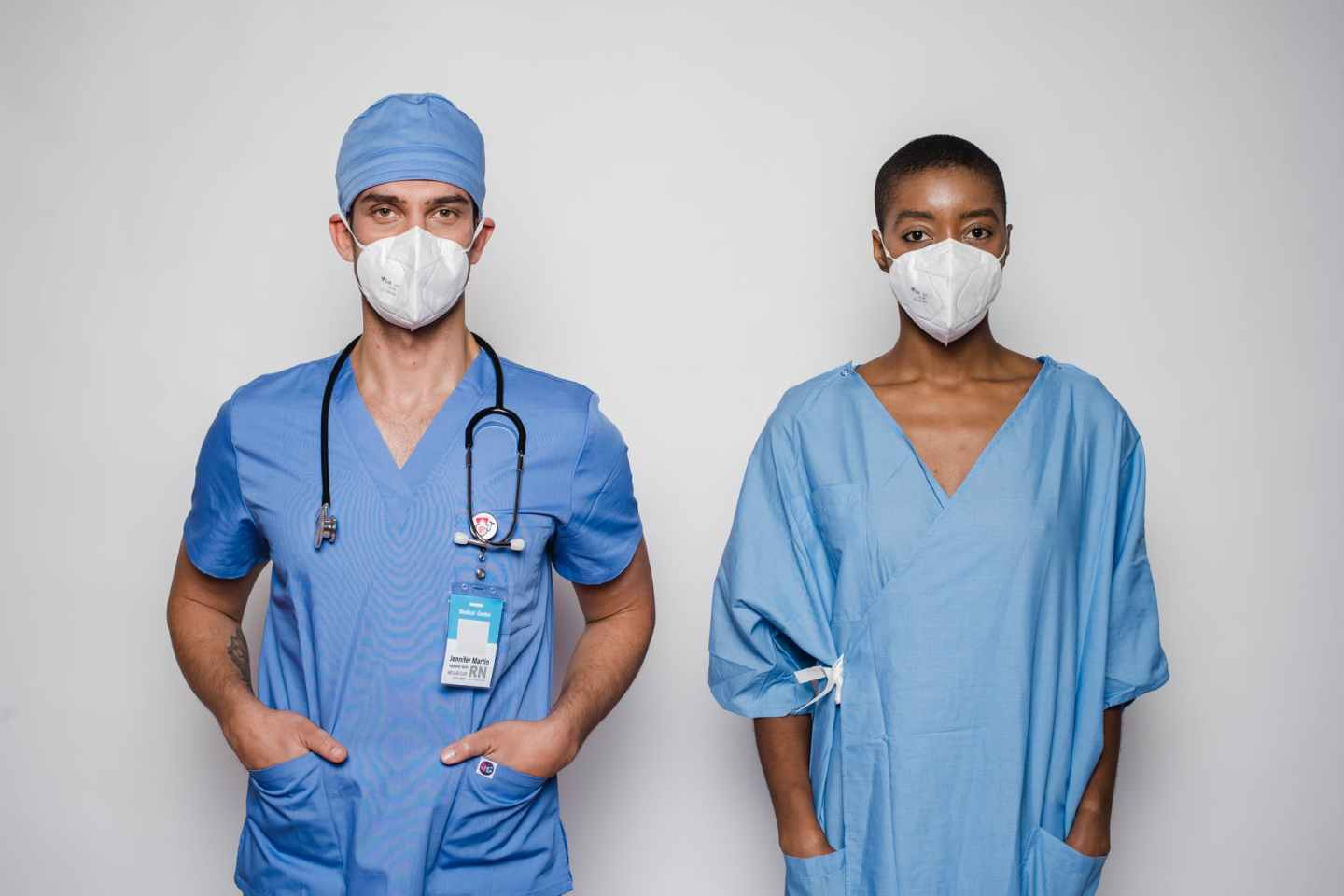 multiracial doctor and patient in uniform and masks