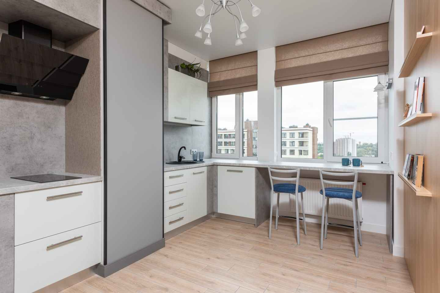 modern kitchen interior with cabinets and counter with chairs