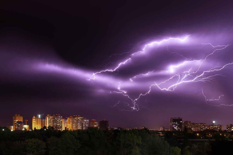 purple lightning at night
