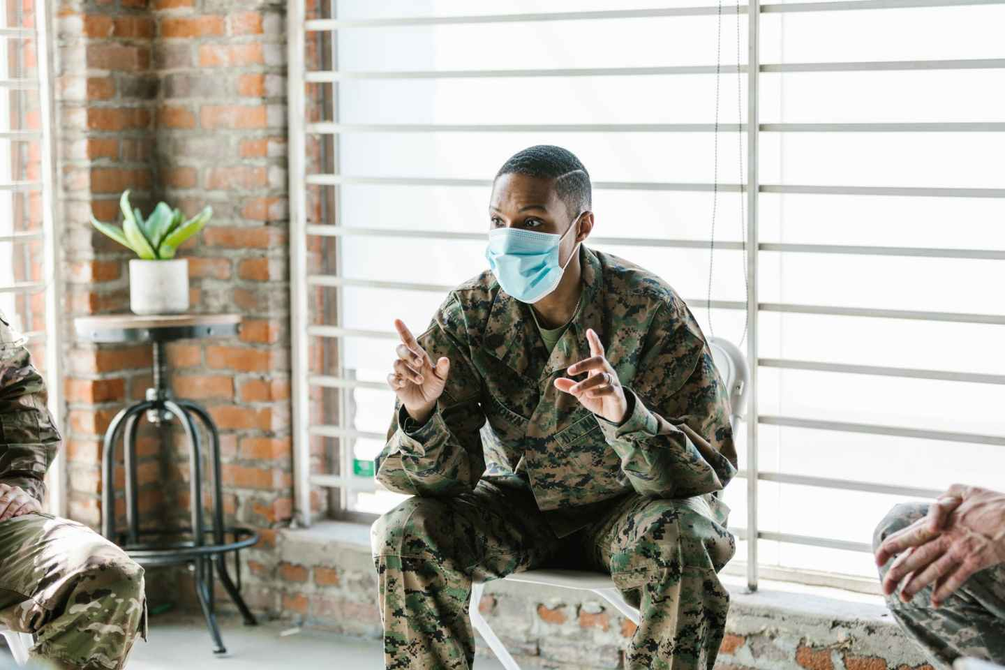 photo of soldier talking with his facemask on