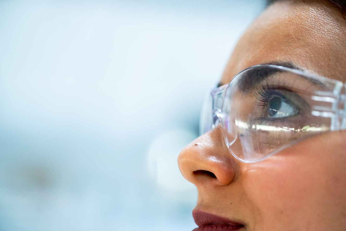 close up photo of woman wearing protective goggles