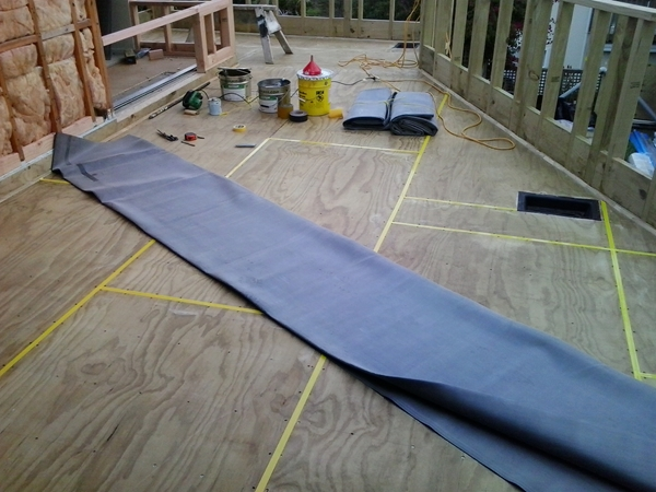 ready to lay, polythene tape installed over the plywood joint gaps
