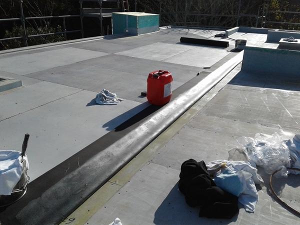 first sheet of 1.5mm Dove Grey Butynol  rubber goes in to internal gutter, glue applied