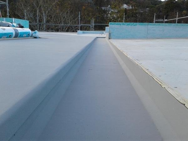 view along internal gutter, turndown lap on left is taped