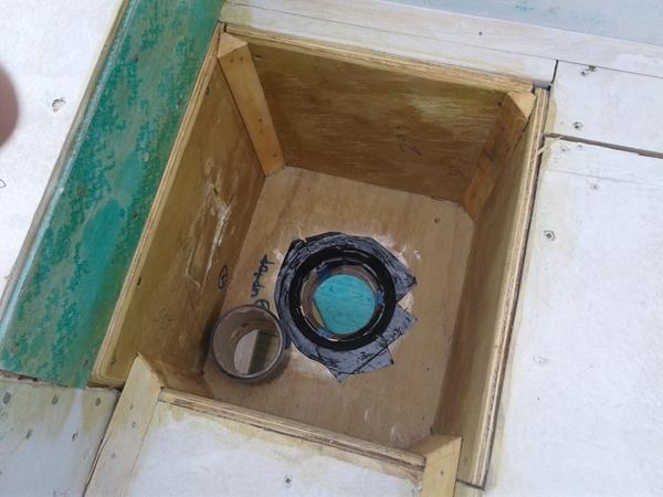 seam tape applied around the brass drain