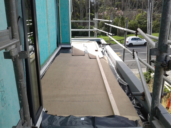 lower north side roof covered with HD polythene and carpet protection  prior to cladding and plaster work