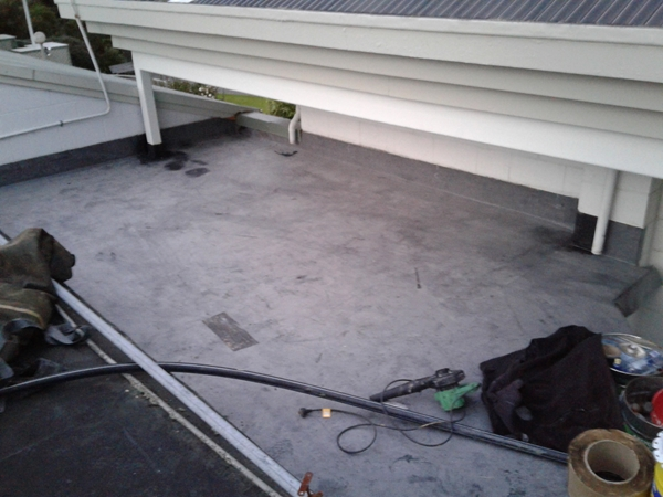 lower half of roof new EPDM installation is complete