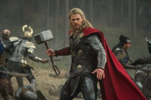 Chris Hemsworth as Thor, swinging his massive hammer about