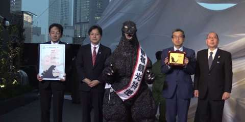 Godzilla, home town giant lizard, makes good.  No word on how they were able to grow the city officials to 600 feet high in order to pose for this picture, nor how they were returned to their normal size.