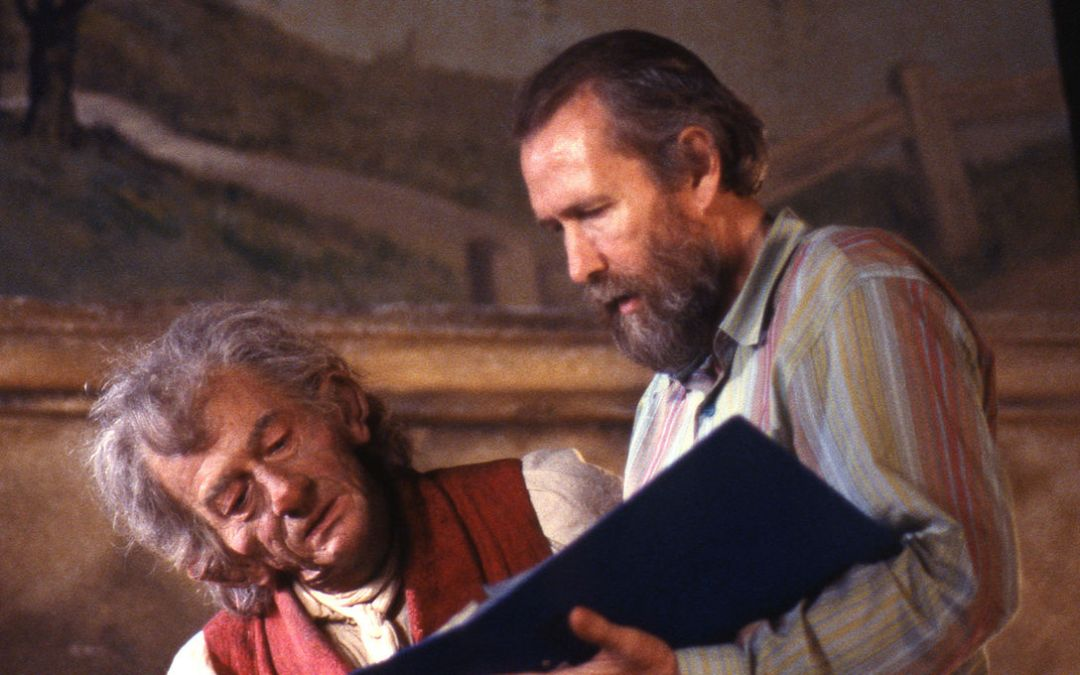 StoryTeller behind the scenes, production on set. John Hurt (L, the storyteller) reviewing the script with Jim Henson.