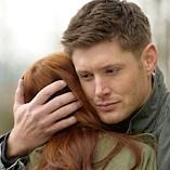 Dean gives Charlie a hug.