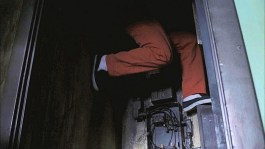 Sam crawls down an air shaft.
