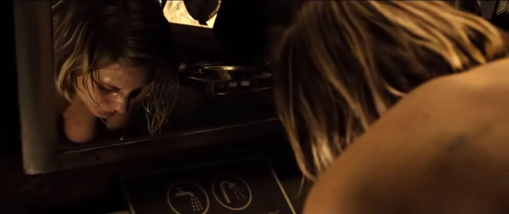 Katee Sackhoff bending over topless in Riddick