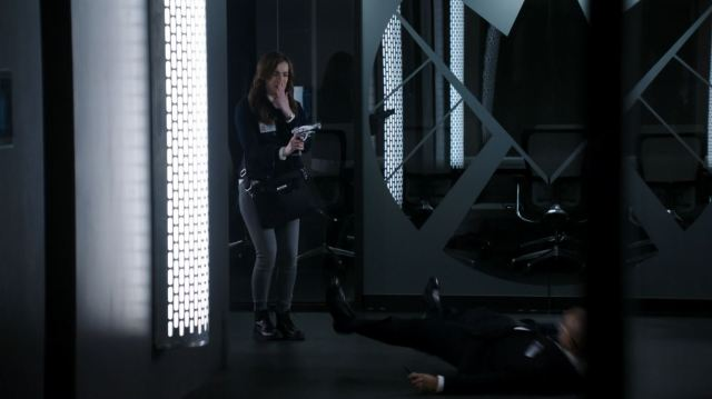 Elizabeth Henstridge as Jemma Simmons shoots a SHIELD agent - The Hub