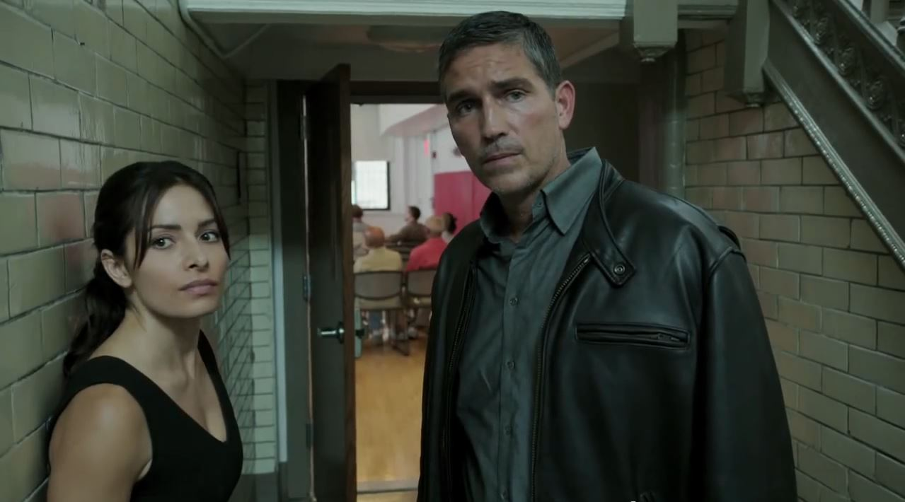 Person of Interest Season 4 Preview - John Reese and Shaw looking at a phone