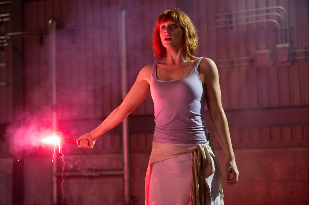 Bryce Dallas Howard as Claire Dearing holding flare - Jurassic World screen