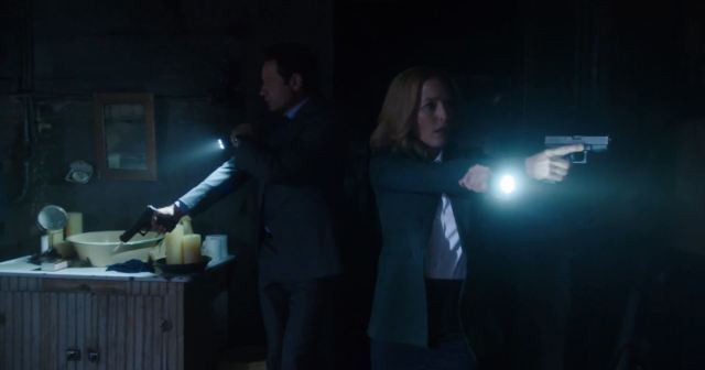 X-Files Revival miniseries. Scully and Mulder enter a dark room