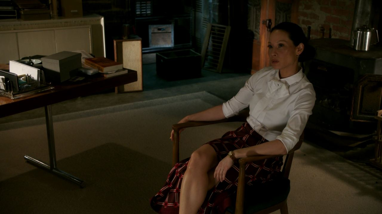 Lucy Liu red long skirt. Elementary S4Ep14 Who Is That Masked Man Review