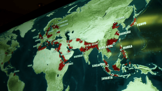 A screen grab from a spreading pathogen map from Contagion (2011), focused on Africa and Eurasia, with red patches surrounding major cities, including Hong Kong.