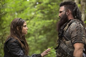 "The 100 -- ""Inclement Weather"" -- Image: HU202a_0620 -- Pictured (L-R): Marie Avgeropoulos as Octavia and Ty Olsson Nyko -- Photo: Katie Yu/The CW -- © 2014 The CW Network, LLC. All Rights Reserved"