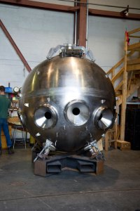 The titanium sphere that forms the cabin with the three viewports being assembled.