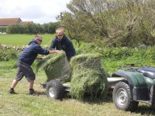 Matt and Jeff wrestle with the bales