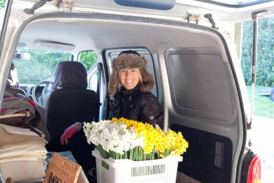 Tamara squidged into the back of the van amongst flowers, props and photographic equipment.