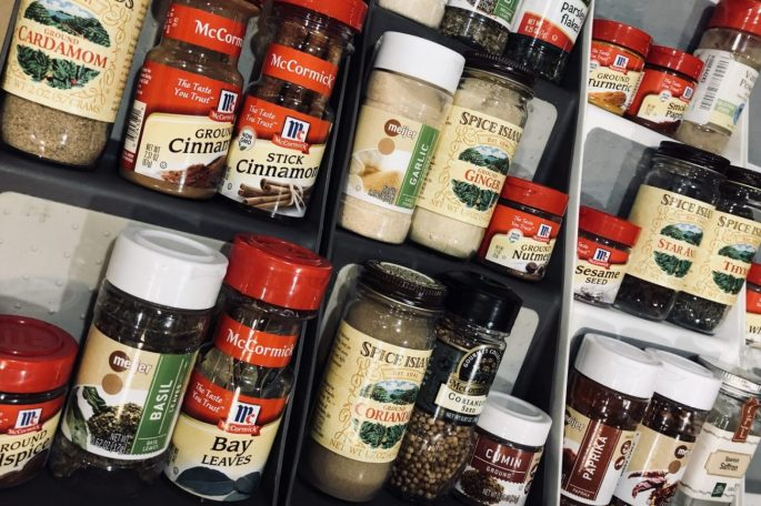Spice rack with a variety of brands and types of spices.