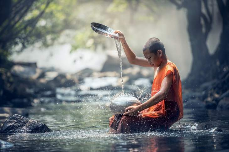 monk playing with water