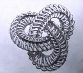 """Un """"nudo trébol"""" combinado con cuatro cintas de Möbius paralelas y un tubo en espiral que va uniendo todo. Toda una joya de la topología."""