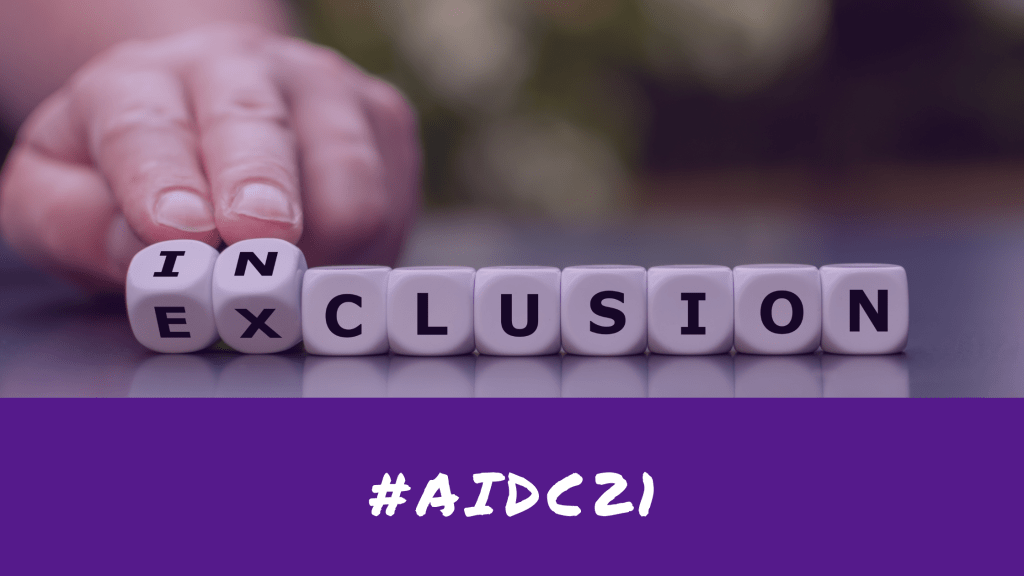 """#AIDC21. Dice that spell """"exclusion,"""" but a person is turning over the """"e"""" and """"x"""" to make the word """"inclusion."""""""